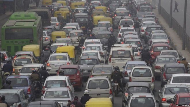 Vehicles sit in traffic on a road shrouded in haze in New Delhi, India, on Monday, Jan. 20, 2014.