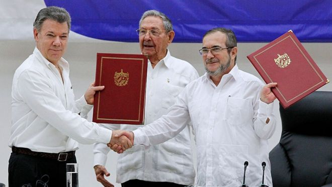 Juan Manuel Santos president of Colombia (L) and Timoleon Jimenez 'Timonchenko' shake hands (R) shake hands during a ceremony to sign a historic ceasefire agreement between Colombian Government and the FARC rebels to end a 50-year conflict on June 23, 2016 in Havana, Cuba