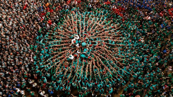 """Castellers de Vilafranca fall down after forming a human tower called """"castell"""" during a biannual competition in Tarragona city, Spain, October 2, 2016."""