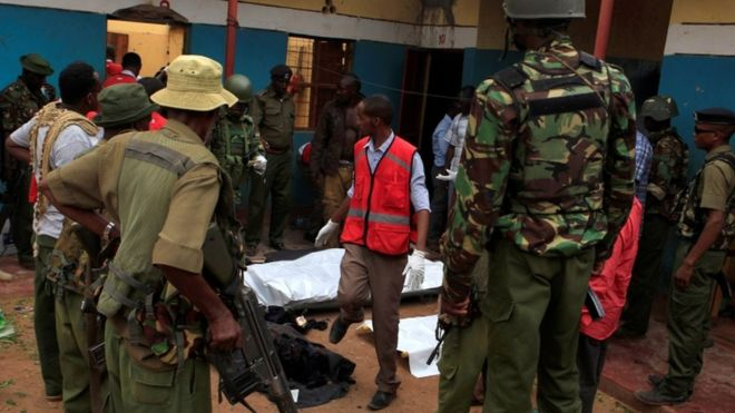 Police officers stand by dead bodies after an attack by Islamist militants from the Somali group al Shabaab in Mandera, Kenya, October 6, 2016