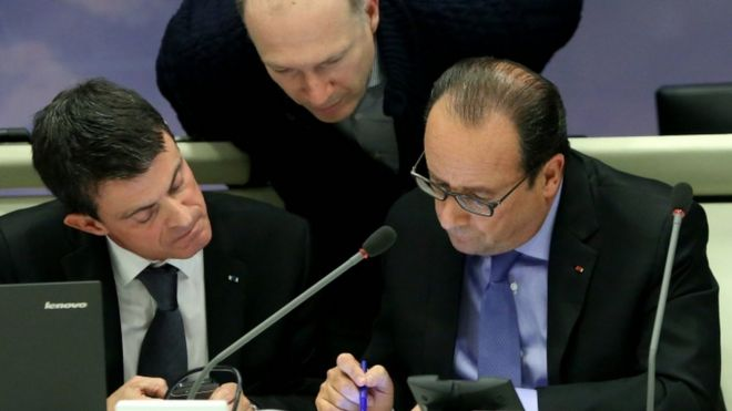French Prime Minister Manuel Valls and French President Francois Hollande attending an emergency meeting at the Interior Minister