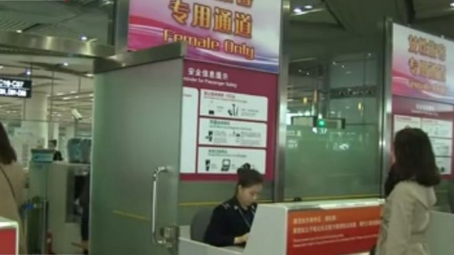 A woman at the Beijing airport women's security check