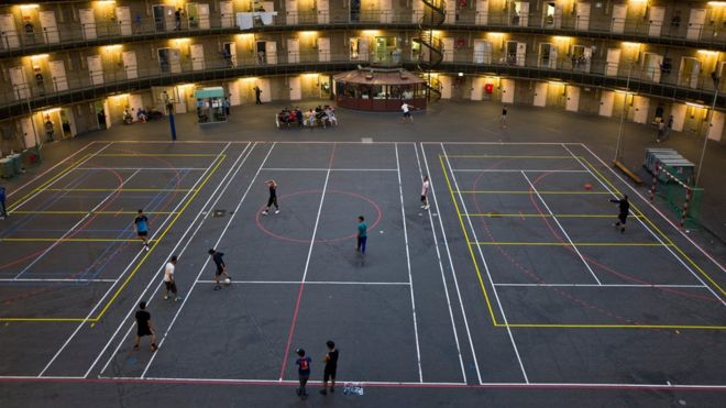 Refugees and migrants play football at the former prison of De Koepel in Haarlem, Netherlands.