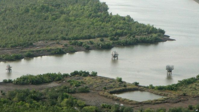 An oil well head is seen near a local community at the mangrove swamps near Port Harcourt Nigeria, Wednesday Feb. 7 2007