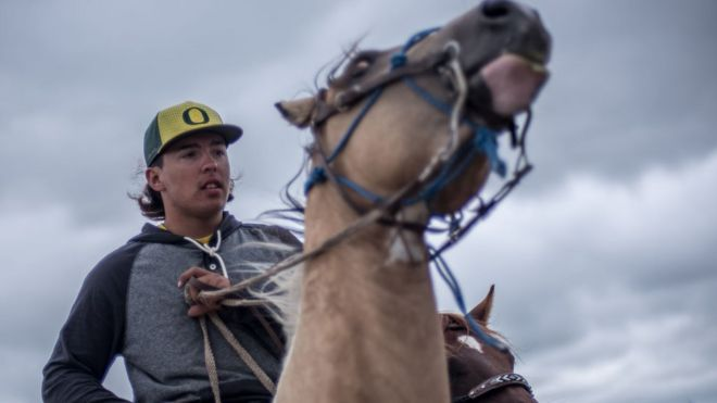"""A cohort of young men patrol the Red Warrior Camp calling themselves """"spirit riders."""""""