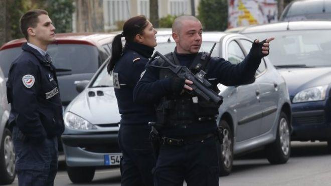 Police officers patrol near the school in Aubervilliers