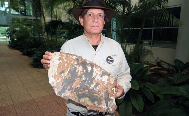Blaine Gibson, who has been searching for parts of the missing flight MH370, shows piece of debris that has been found