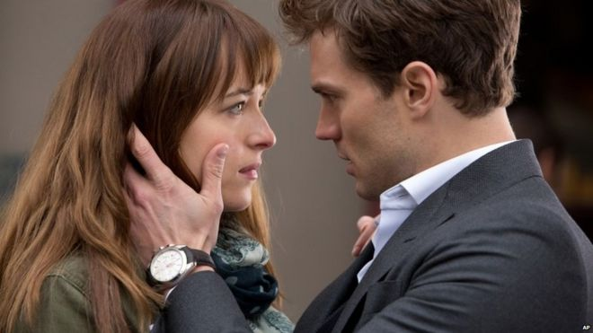 Dakota Johnson and Jamie Dornan appear in Fifty Shades of Grey