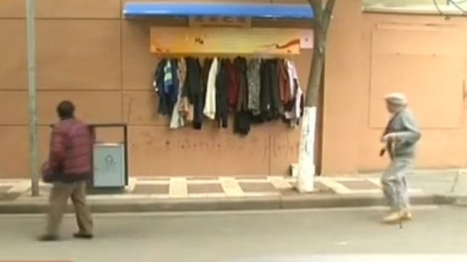 Clothes hung on a so-called wall of kindness