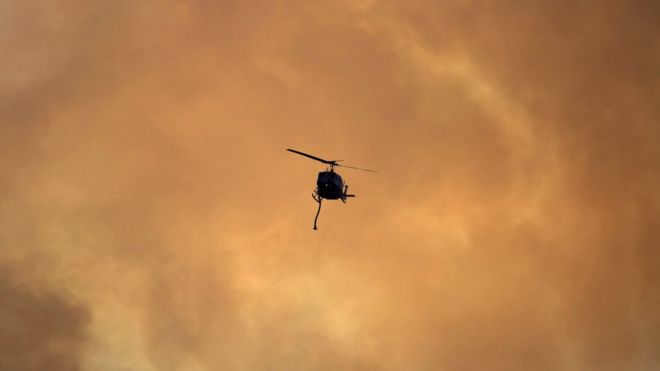 Helicopter battles fires in California