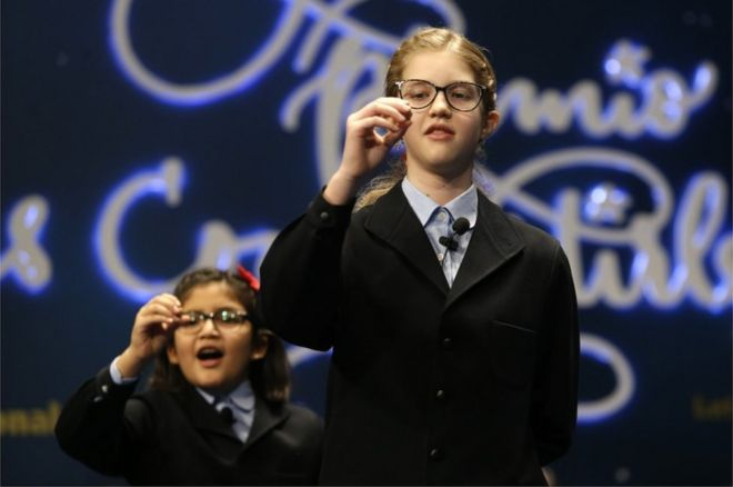 School children sing out the number of the top prize of Spain's Christmas lottery known as