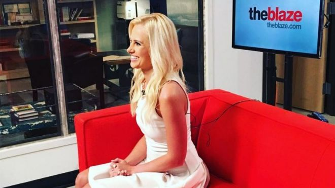Tomi Lahren sitting on a couch in front of a screen for 'theblaze'
