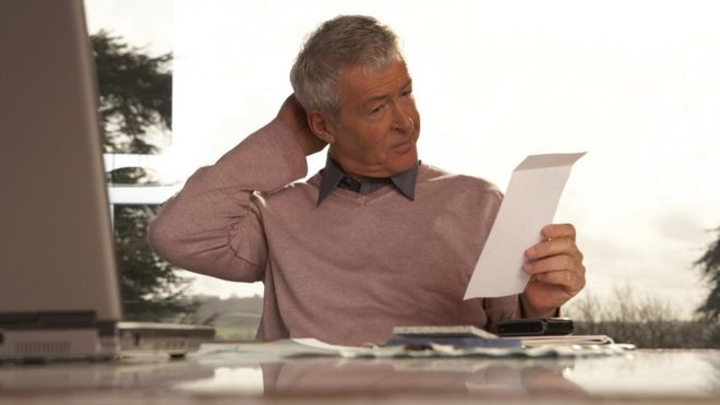 Cash Management Skills Man looking at paperwork