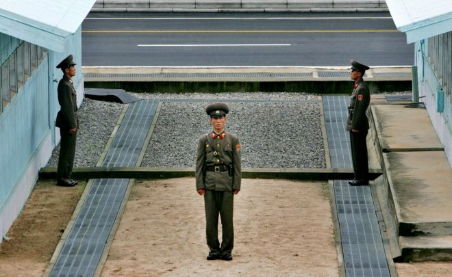North Korean soldier stands next to the demarcation line in Panmunjom, on the border between North Korea and South Korea Tuesday 7 August 2007.