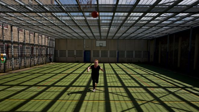 Mongolian migrant Naaran Baatar, 40, plays basketball