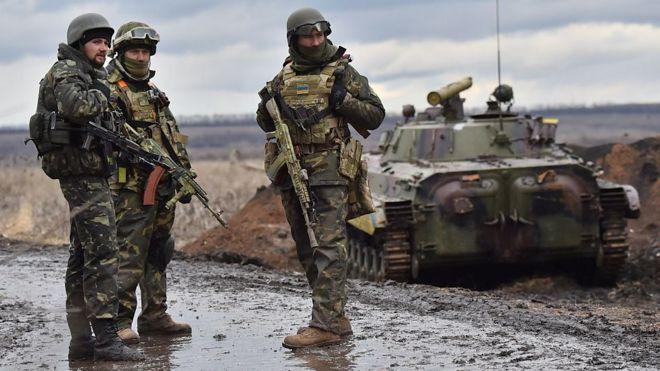 Ukrainian soldiers on the frontline outside the eastern Ukrainian city of Debaltseve, Donetsk region, in December 2014.