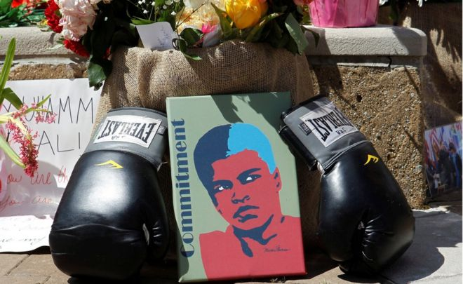 Fans of Muhammad Ali, the former world heavyweight boxing champion, leave pictures and personal mementos as they pay their respects at the Ali Center in Louisville, Kentucky, U.S. June 7, 2016