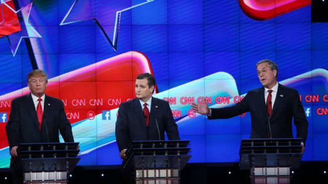 Republican presidential candidate Jeb Bush (R) speaks as Donald Trump (L) and U.S. Sen. Ted Cruz (R-TX) listen during the CNN Republican presidential debate on December 15, 2015 in Las Vegas, Nevada.