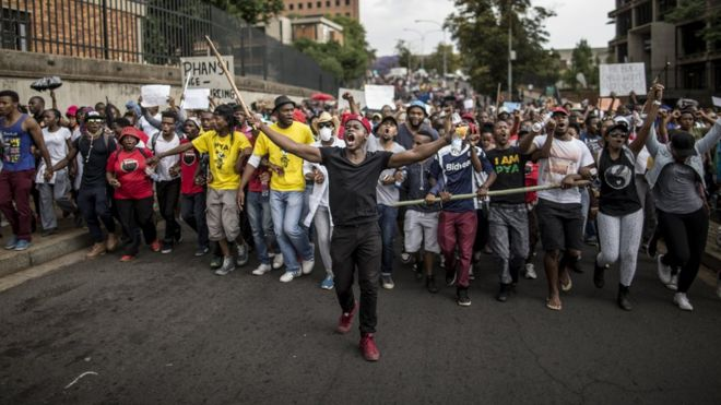 Students march through the campus of the University of the Witwatersrand in Johannesburg on October 21, 2015, during a protest against fee hikes. Universities in Cape Town, Johannesburg, Pretoria and other cities have halted lectures during several days of protests against fee increases that many students say will force poor blacks further out of the education system.