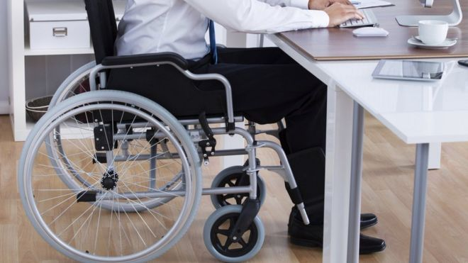 Disabled man at desk