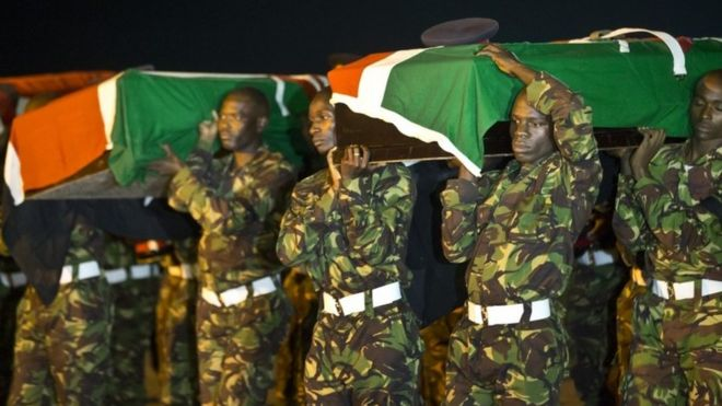 Military pallbearers carry the coffins of four Kenyan soldiers who were killed in Somalia, at a ceremony to receive their bodies which were airlifted to Wilson Airport in Nairobi, Kenya Monday, 18 January 2016