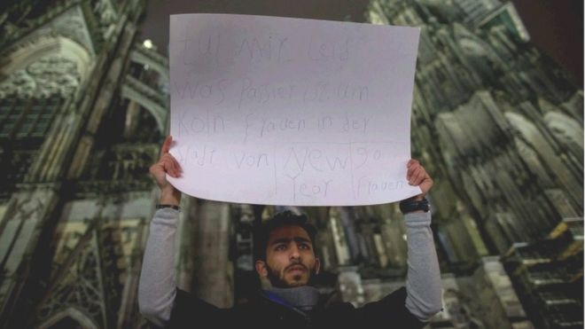 "A man hold a placard reading ""Sorry for what happened with the woman in Cologne in New Year""s Eve, 90 women"" outside the main station in Cologne, Germany, 06 January 2016."