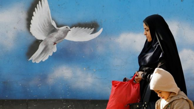 An Iranian woman and child walk in a street in Tehran, Iran, 16 January 2016