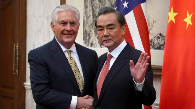 China's Foreign Minister Wang Yi (R) gestures while shaking hands with U.S. Secretary of State Rex Tillerson before a bilateral meeting at the Diaoyutai State Guesthouse in Beijing on March 18, 2017.