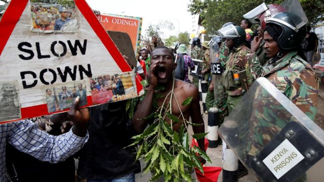Riot policemen stand guard as supporters of Kenyan opposition National Super Alliance (NASA) coalition protest in Nairobi, Kenya 11/10/2017