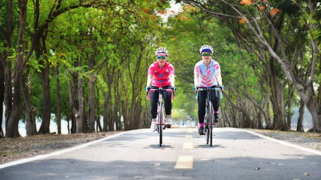 Two women cycling on road bikes