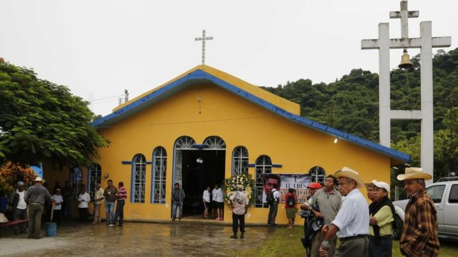 People gather at Our Lady of Asuncion Church in Paso Blanco, Veracruz state, Mexico, for funeral Mass in memory of Catholic priest murdered in Veracruz. 21 Sept 2016
