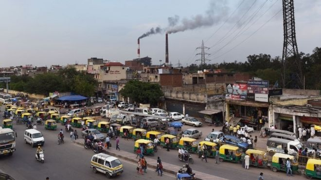 smoke billows from two smoke stacks at the coal-based Badarpur Thermal Station in New Delhi.