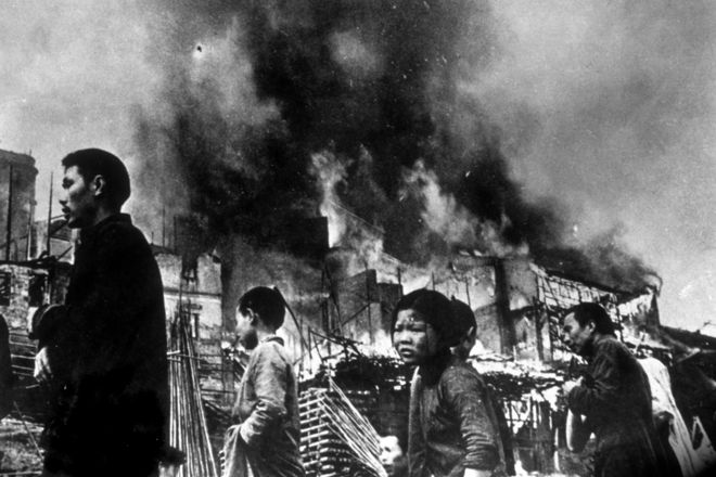 circa 1937: Chinese refugees streaming through the wrecked streets of Chungking, after it had been heavily bombed by the Japanese