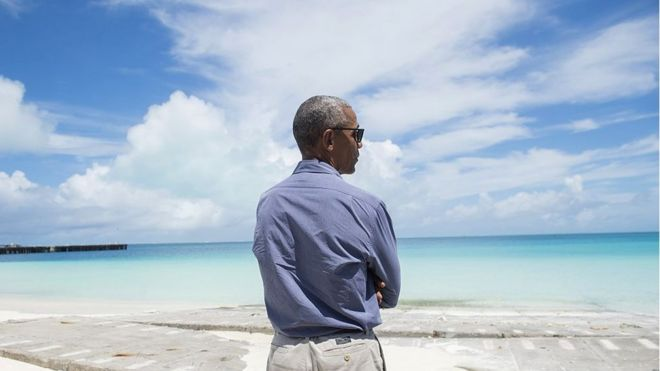 Obama looking out over the ocean
