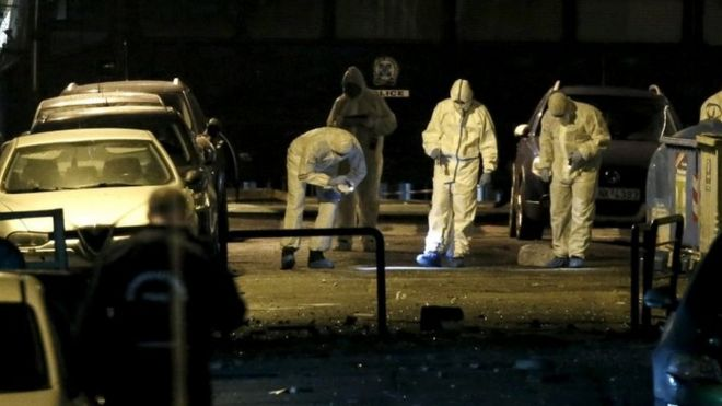 Forensic experts gather evidence at the blast site in central Athens. Photo: 24 November 2015