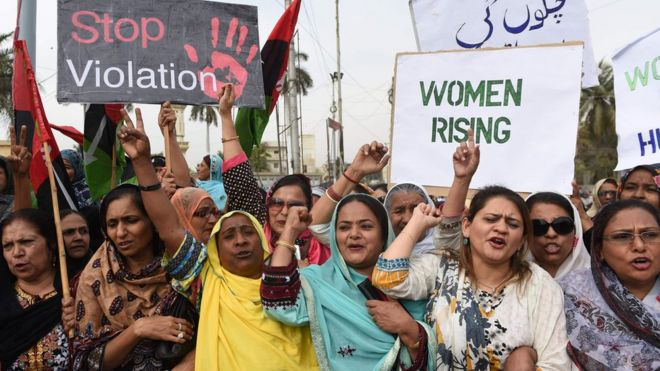 Activists of The Pakistan People's Party hold placards at rally to mark International Women's Day in Karachi on March 8, 2016