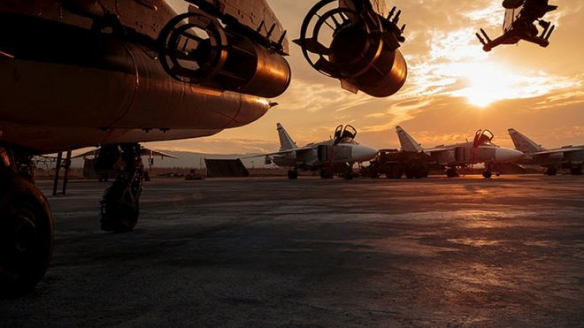 This photo taken on Friday, Dec. 18, 2015 and provided by the Russian Defense Press Service, shows a Russian Su-25 ground attack jet parked at the Hemeimeem air base in Syria