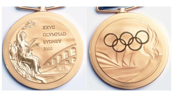 Deux côtés de la médaille olympique de 2000