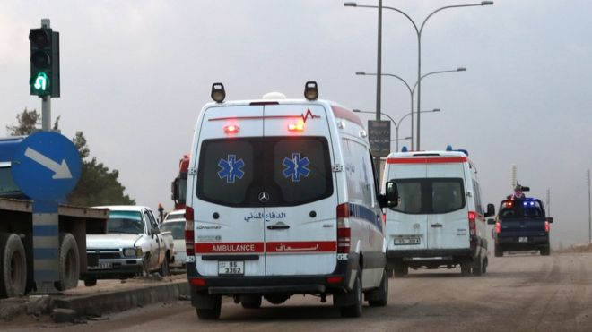 Ambulances leave the King Abdullah bin al Hussein Training Centre in Muwaqqar on the outskirts of Amman, Jordan, on Monday.