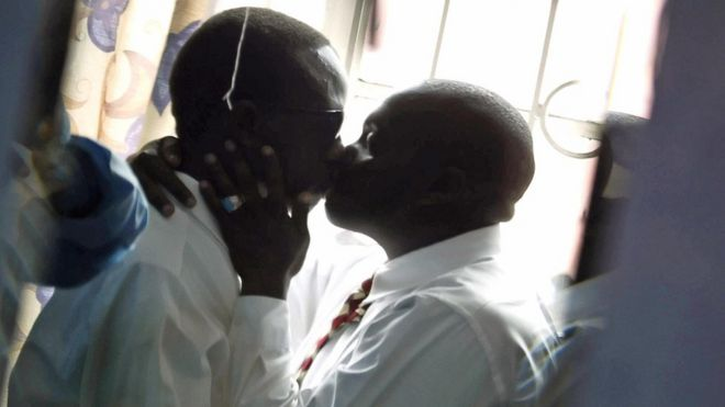 Gay men kiss in Kenya