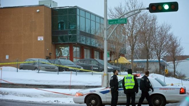 Municipal police patrols the scene where two gunmen opened fire in a Quebec City mosque.