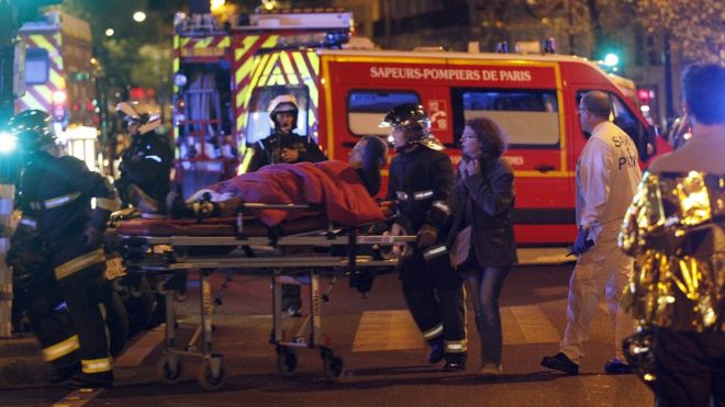 Medics move a wounded man near the Boulevard des Filles-du-Calvaire after an attack on 13 November 2015 in Paris, France