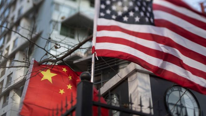 US and China flags together outside an international school in Beijing