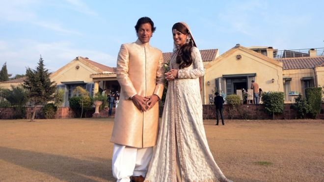 File photo: Imran Khan and Reham Khan pose during their wedding ceremony in Islamabad, 8 January 2015