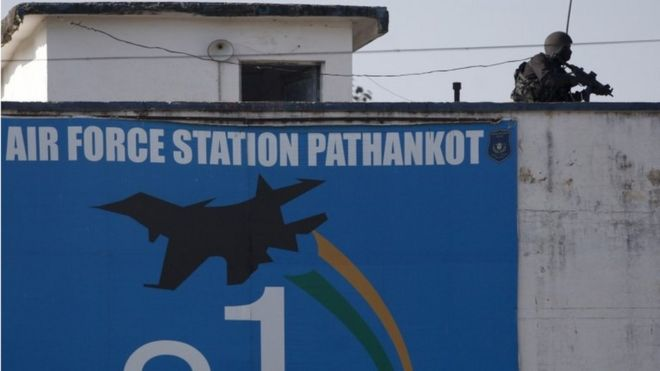 An Indian military commando is seen on the top of a building at the Indian air force base in Pathankot, India, Tuesday, Jan.5, 2016