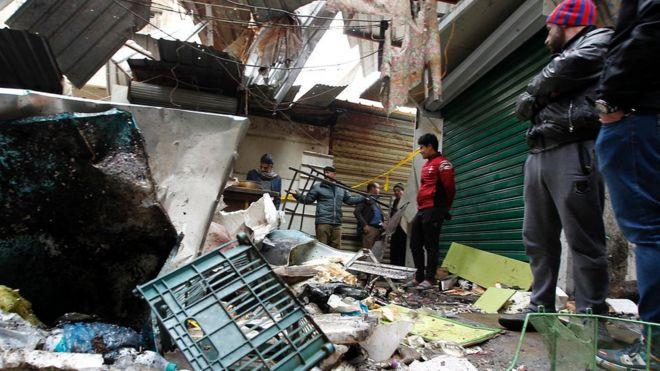 Iraq Baghdad: 21 dead as twin bombs rip through market