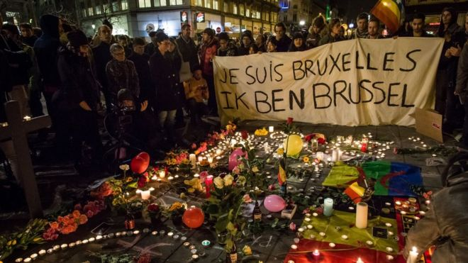 Floral tributes, candles and flags in front of the Place de la Bourse on March 22, 2016