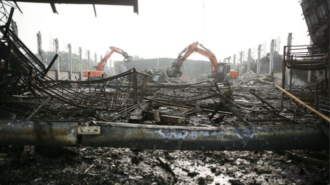 Excavators tear down a burnt down hall at Messe Duesseldorf, Germany, 8 June 2016