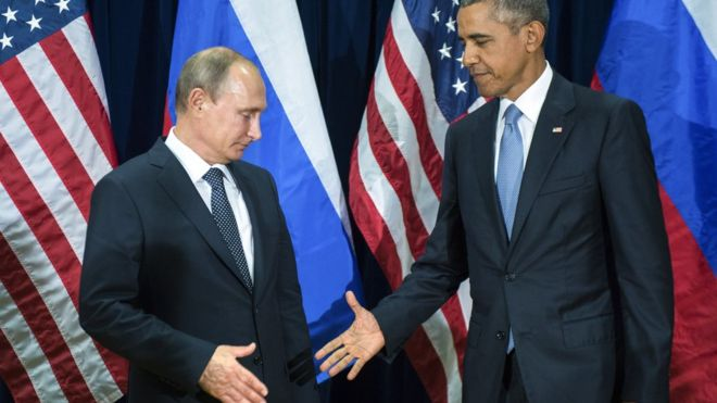 Putin and Obama shake hands at the UN on 28 September 2015