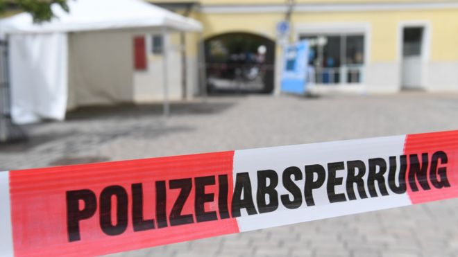 Police tape blocks access to the area in central Ansbach where the explosion took place (25 July 2016)